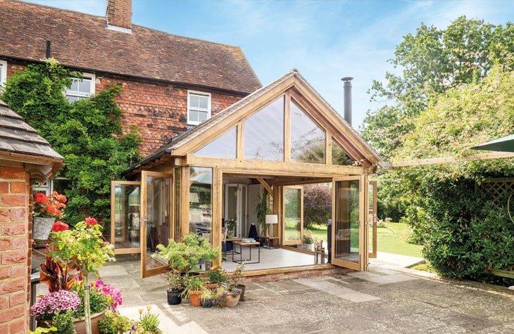 Oak framed garden room with glazed gable and feature bi-folds