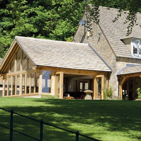 Oak framed garden building with matching tile roof to existing