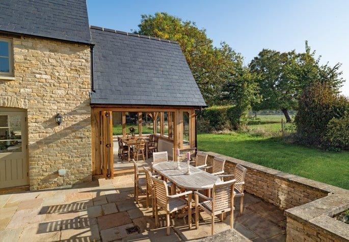 Oak framed garden room with courtyard