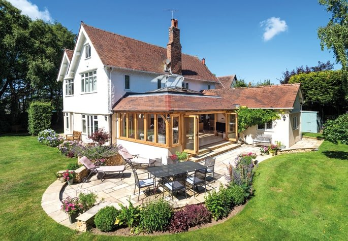 Oak framed orangery extension with matching roof tiles