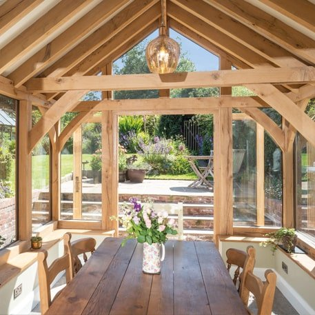 Oak framed garden room with exposed rafters