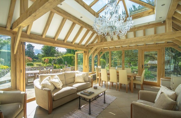 Oak framed mansard orangery with exposed oak rafters and bifolds
