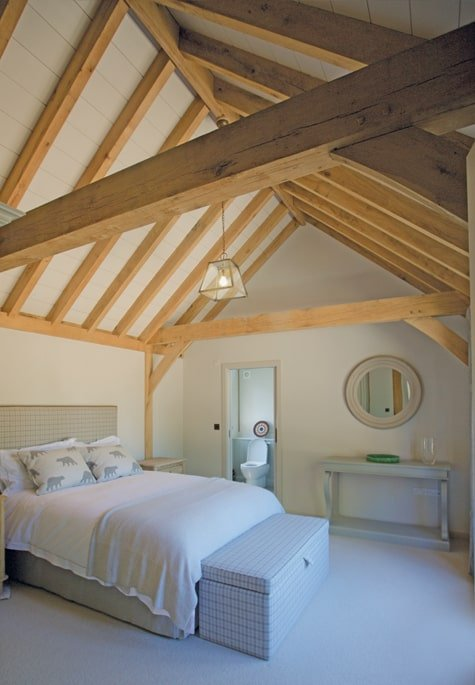 Oak framed bedroom with rustic exposed rafters