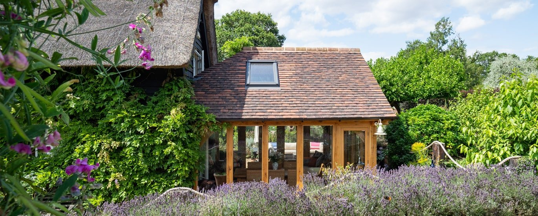 Oak framed garden room on thatched period property