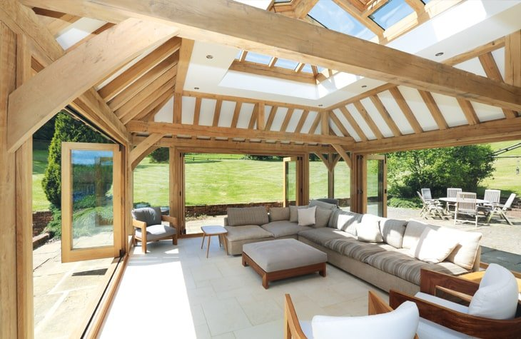 Oak framed orangery with bi-folds and exposed rafters