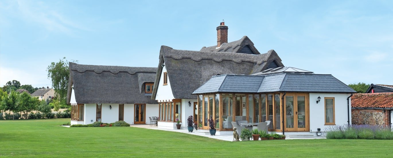 Oak framed orangery to thatched roof