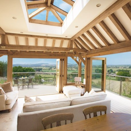 Oak framed orangery with exposed rafters int