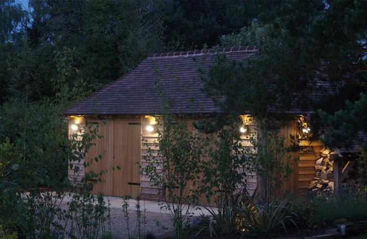 Oak framed garage by night