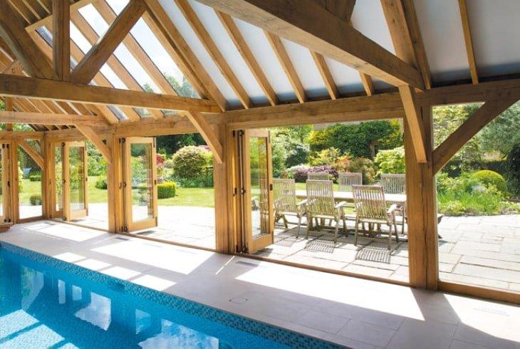 Oak framed pool building with bi-folds